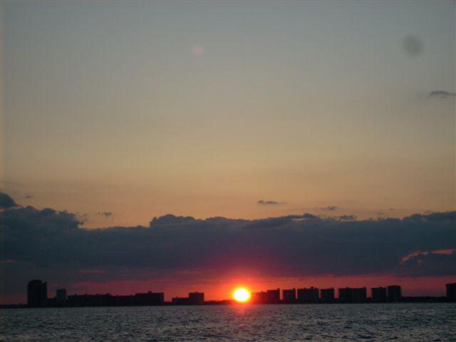 orange-beach-sun-set-sailing-charter-trips